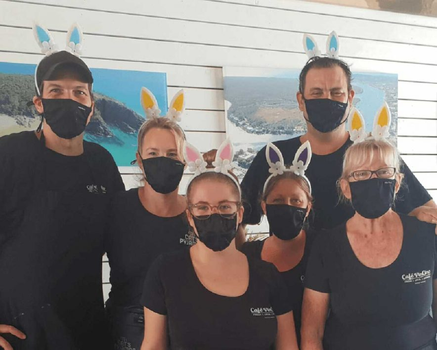 Cafe VinCino staff wearing masks and bunny ears for Easter